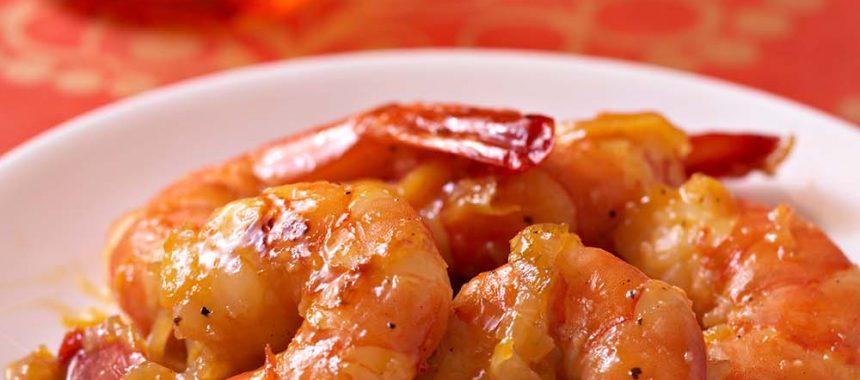 Poêlées de gambas au miel, gingembre frais et oranges